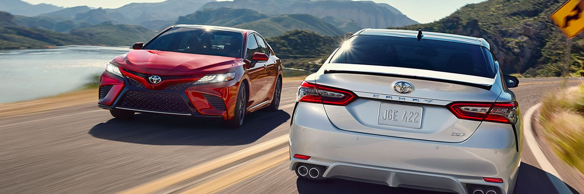 2018 Camry XSE V6 shown in Ruby Flare Pearl and 2018 Camry XSE V6 shown in Wind Chill Pearl