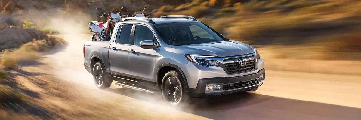 2020 Honda Ridgeline driving on dusty road